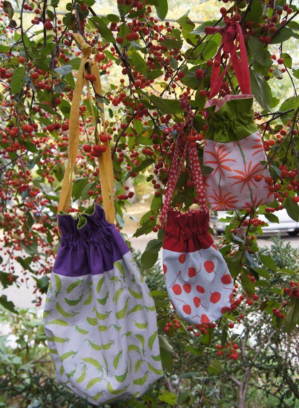 "2 sizes of Drawstring bags made with ""Dogs at the Farmers Market"" fabrics"