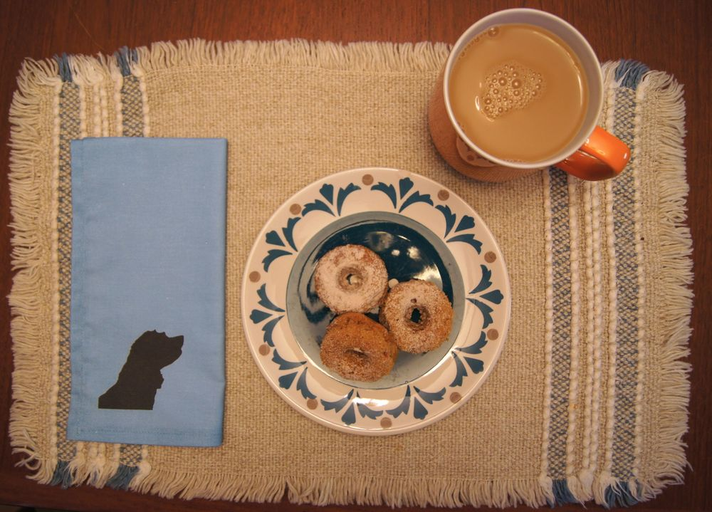 Shadow Play Table Napkins with baked mini donuts and Chai tea