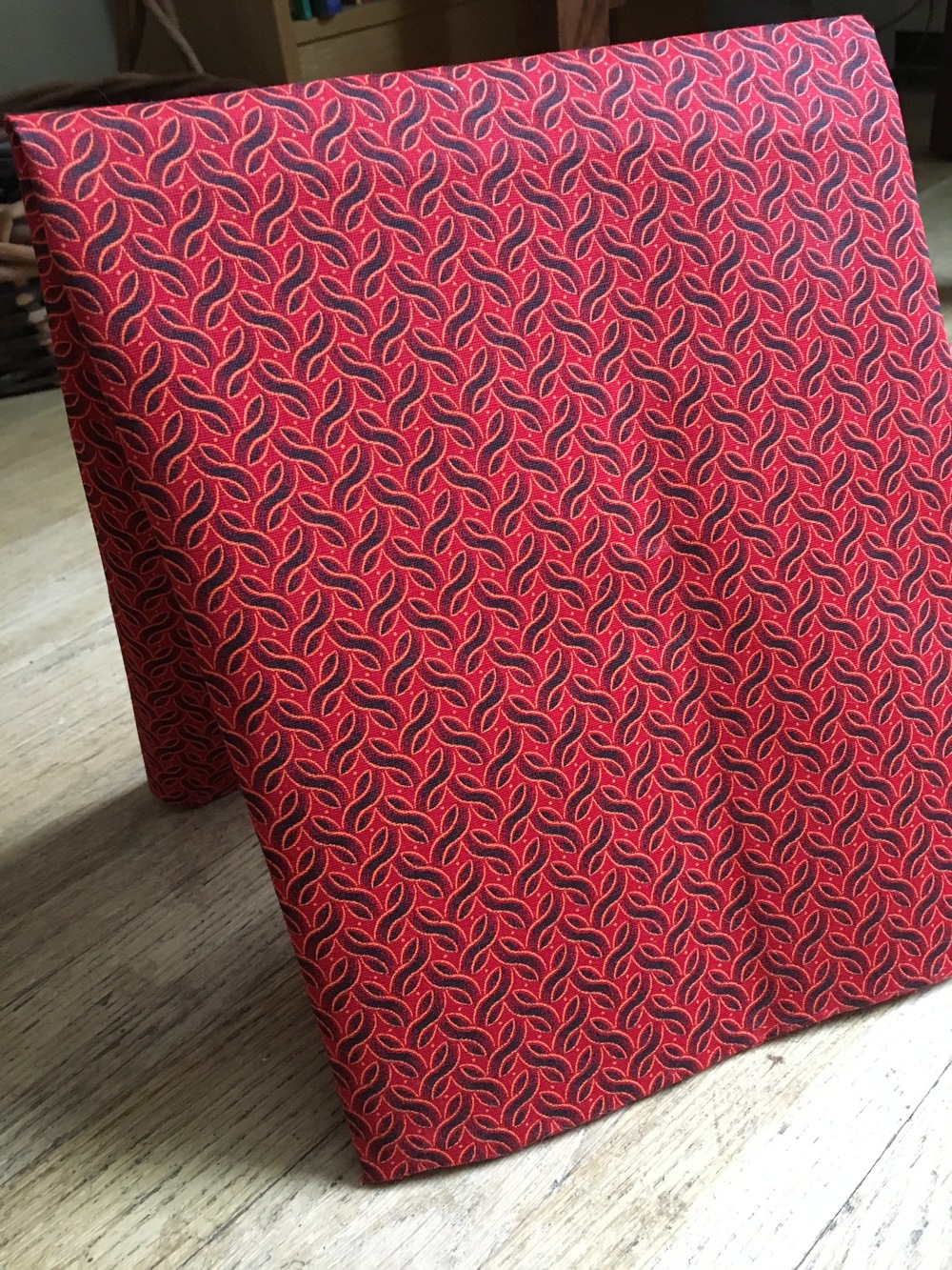 Shweshwe red and black fabric.jpg