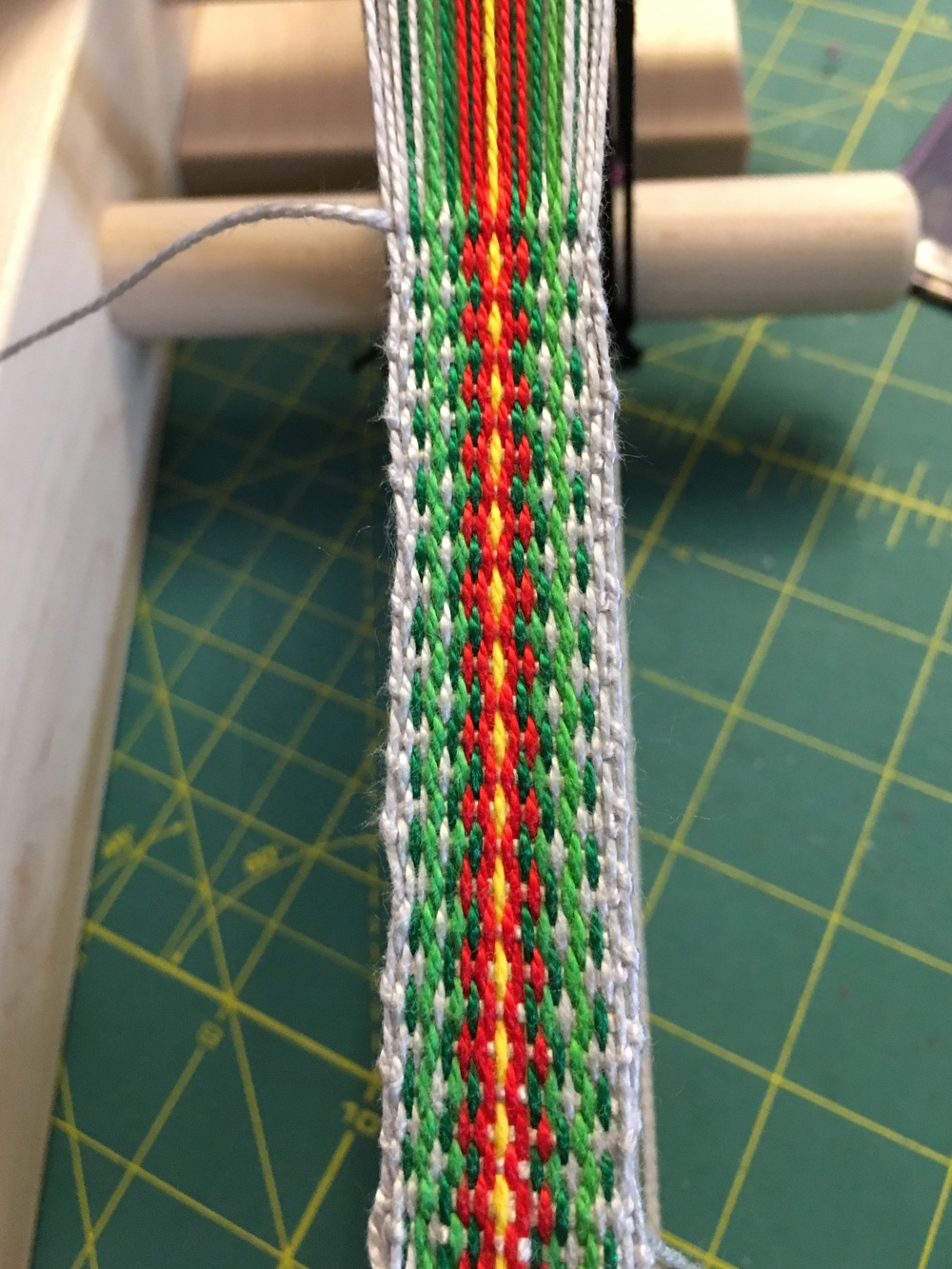 Weaving Christmas Inkle 2nd attempt.jpg