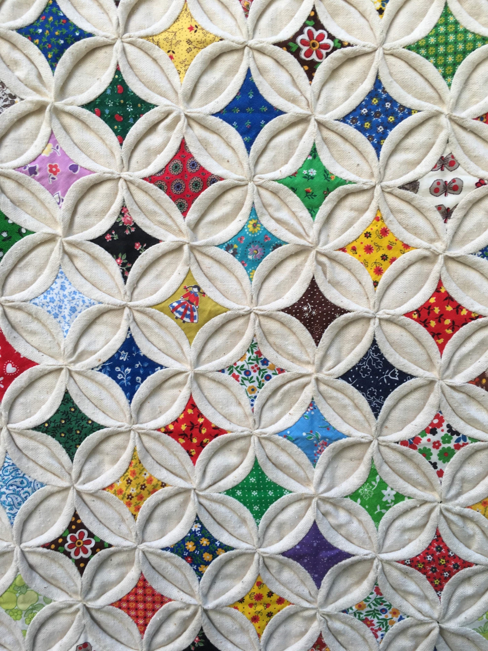Detail of a 1970s Cathedral Windows Quilt