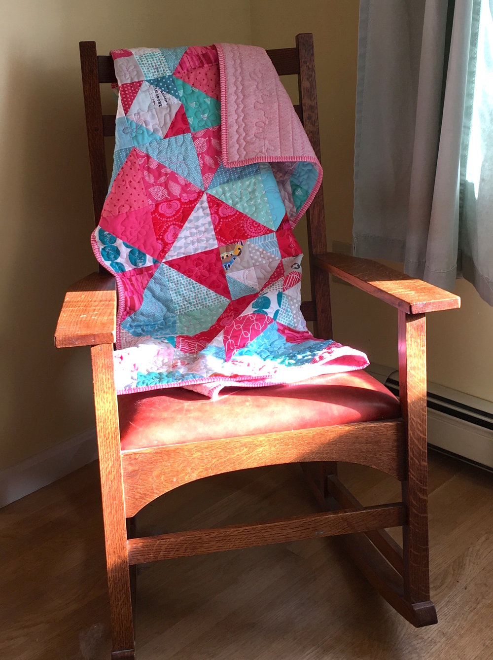 Quilt Pink and Aqua in chair.jpg