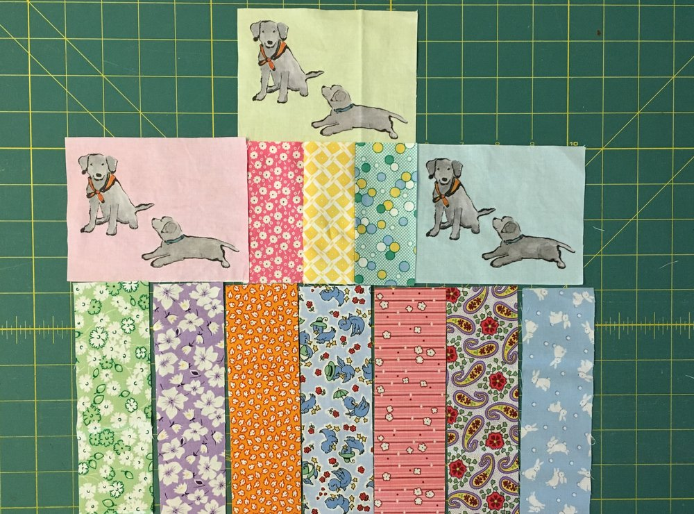 Some of the 1930s feed sack reproduction fabrics for the Lab Puppies Quilt