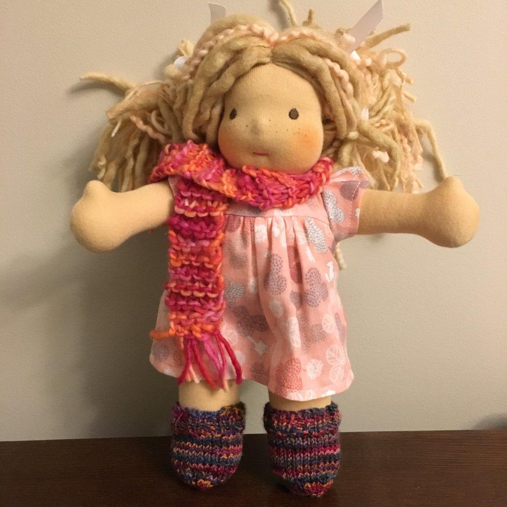 A  Bamboletta Little Buddy  with her new socks!