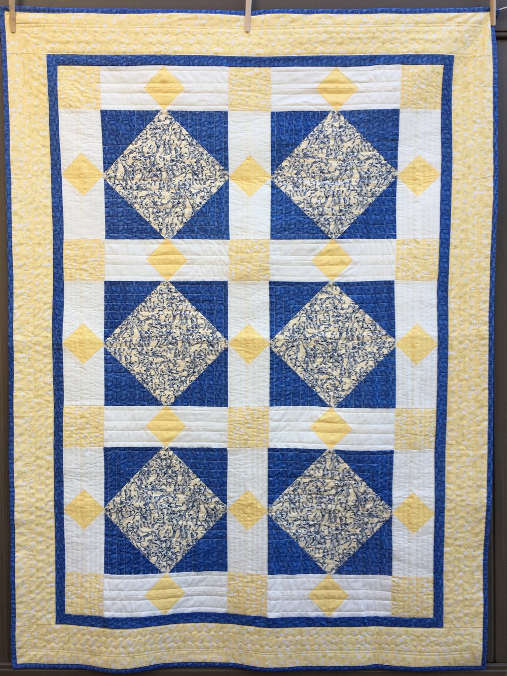 """Dalmations in Diamonds"" lap quilt"