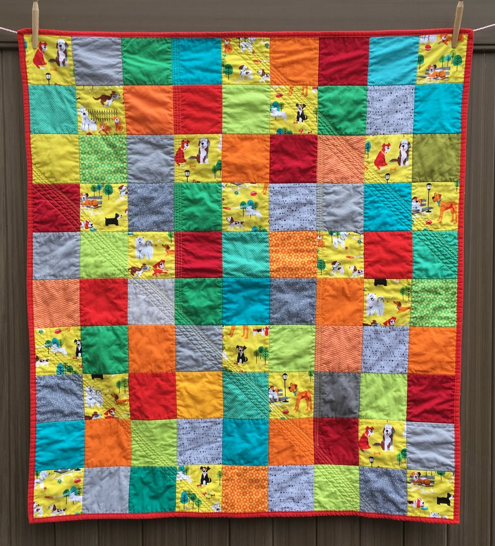 """Dogs + Sunshine"" Charm Square Baby Quilt with Bright Colors and Dogs 39 x 44 inches"