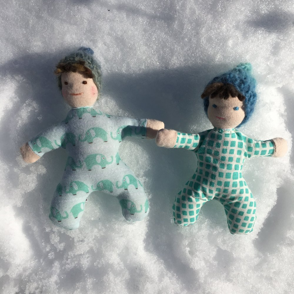 6 inch and 5 1/2 inch soft Waldorf dolls making Snow Angels!