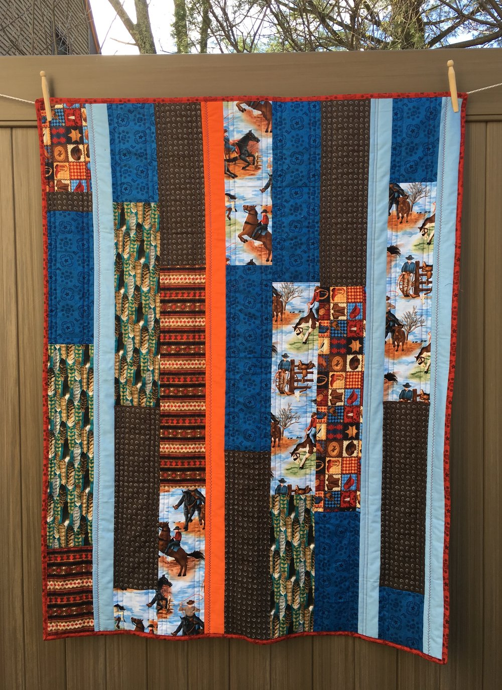 Variation of Modern Textiles' Strip Quilt, approx 42 x 50 inches