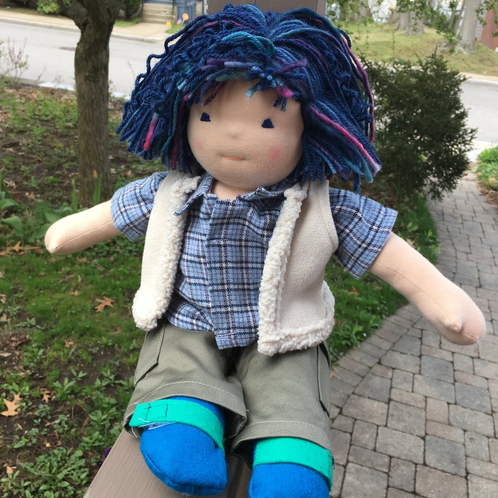 Here he is sitting. I managed to sew in decent leg folds on this doll.  He's wearing clothes made by the Bamboletta Sewing Mamas! (I made the shoes).   NOTE:  Notice the difference in his hair in these two photos. The first humid day we had, Douglas lost most of his curls!  I used merino superwash yarn and it just relaxed in the humidity. Next time I think I'll use yarn that felts and smaller needles than the #10 US needles I chose this time!
