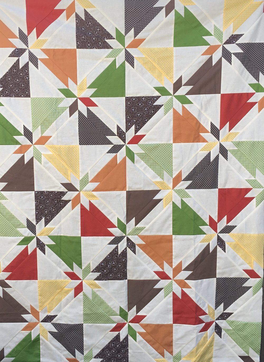 Hunter's Star quilt top in an assortment of fall colors