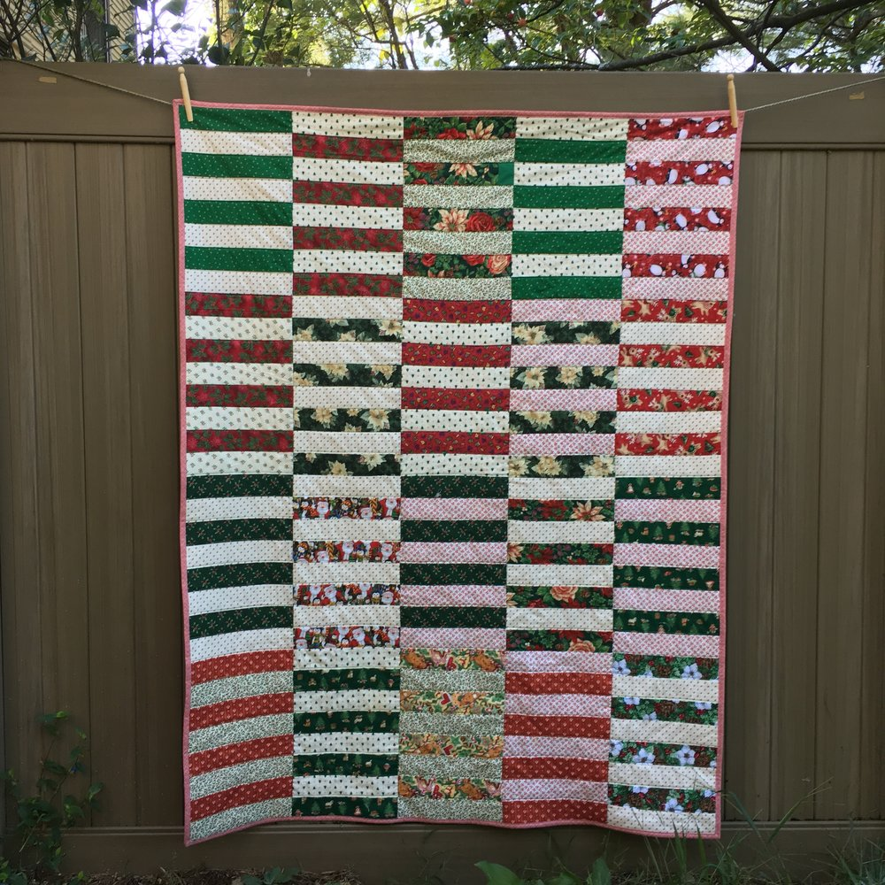 "Christmas version of Tula Pink's ""Lolly"" pattern, 46 x 61 inches"