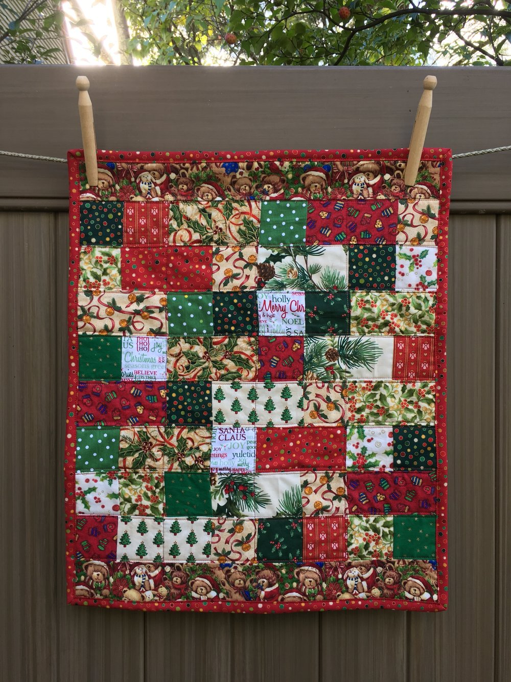 Doll sized Christmas Quilt. 16 1/2 x 20 inches