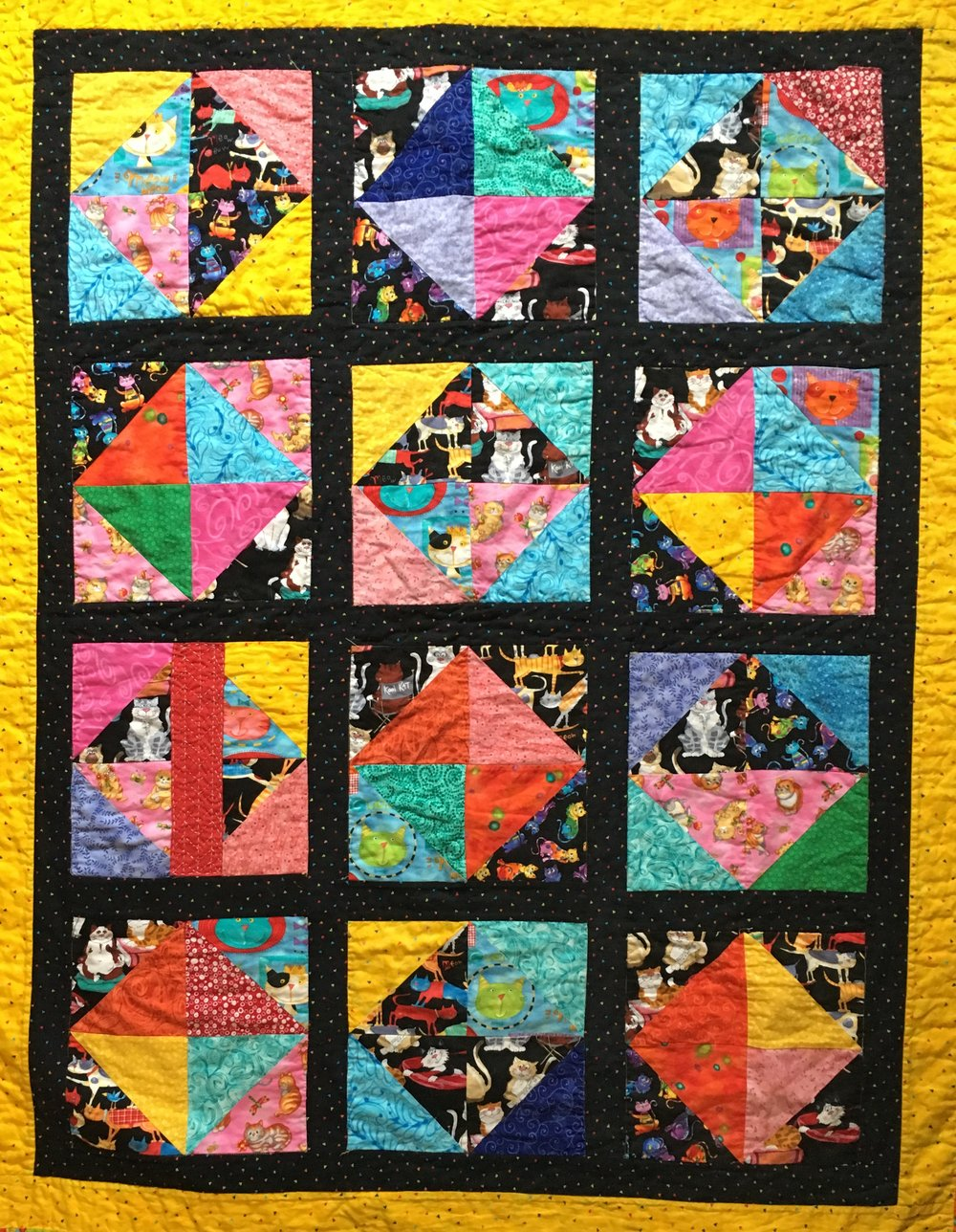 The sashiko mend plays happily with the blocks in this quilt.  (Its in the far left rowd, 3rd block down).