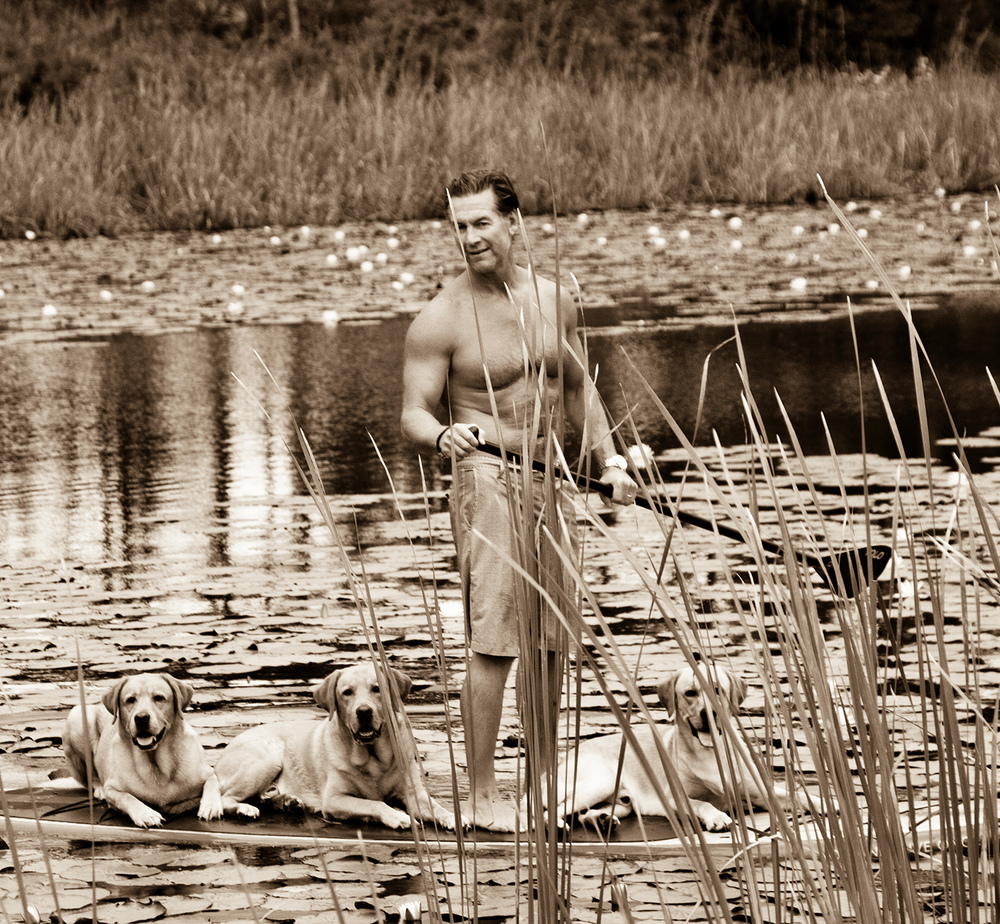 Matthew Howard and his three yellow labs