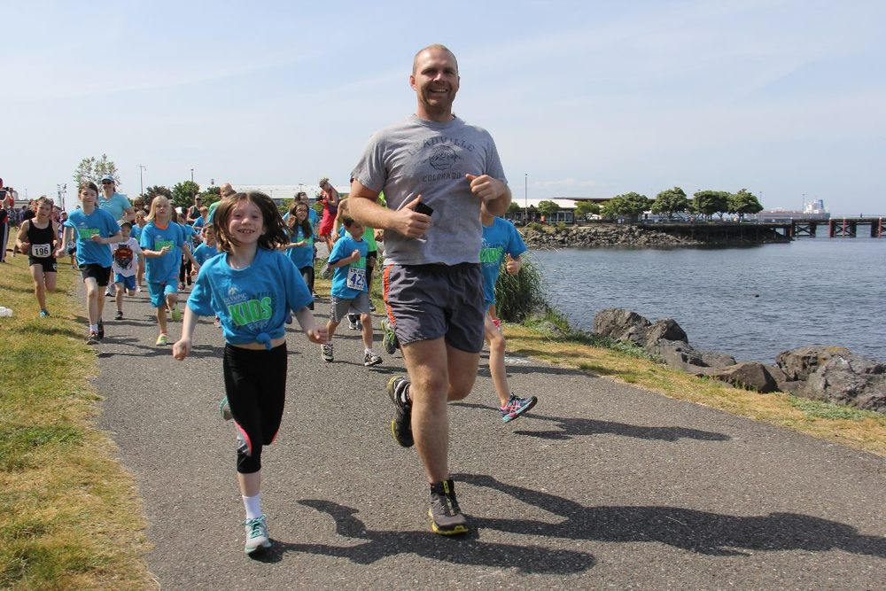 Rob running the North Olympic Discovery Kid's Marathon with his niece.