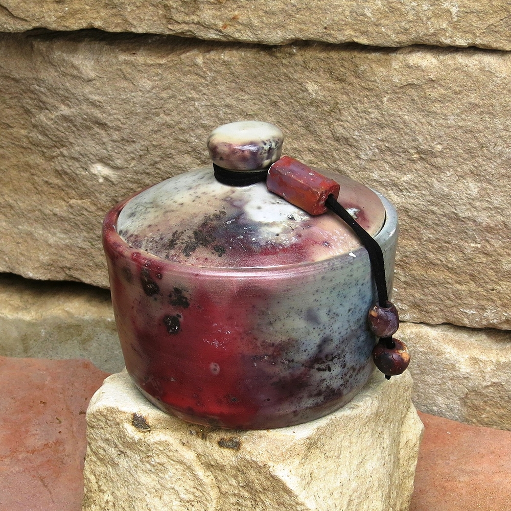 Small red lidded with beads.jpg