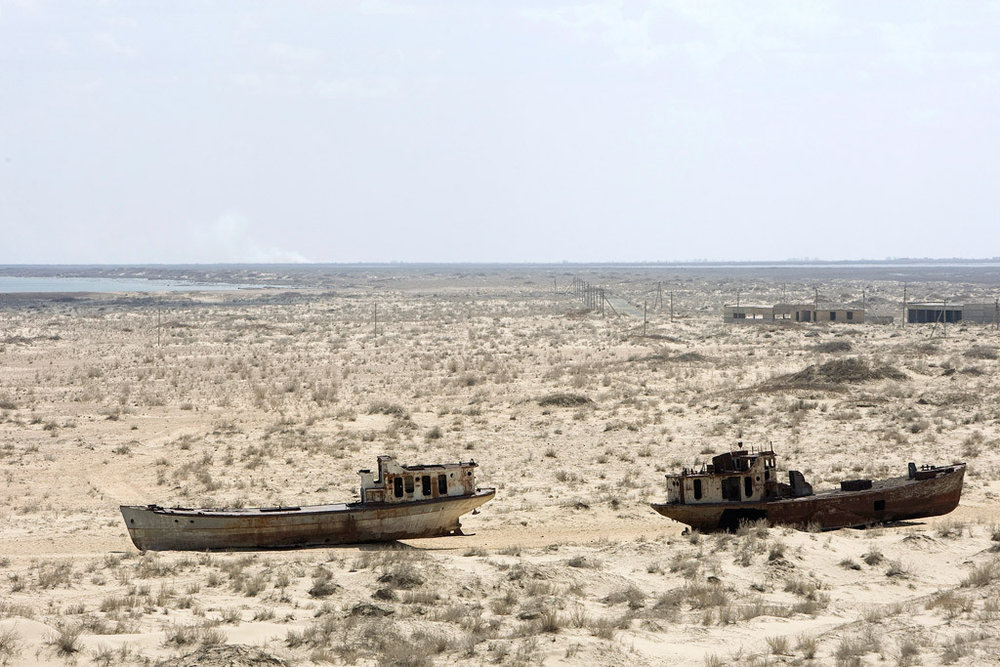 Two boats lie forever adrift on the Aral plain. Photo: EJF Foundation.