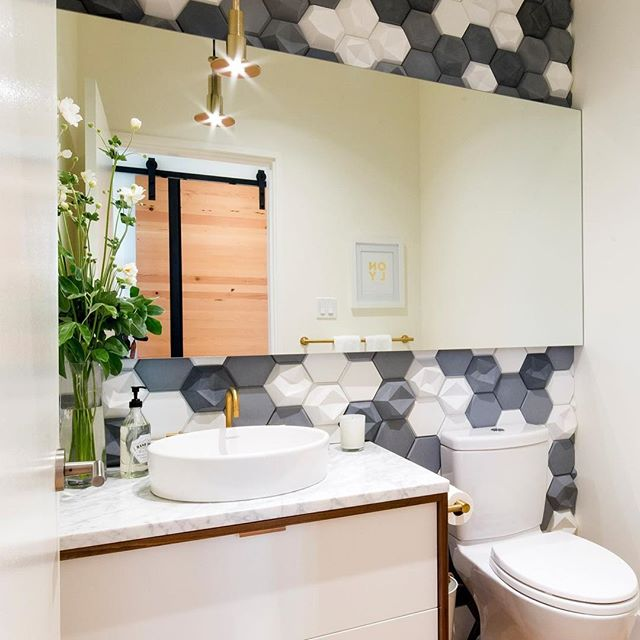 Obsessed with the amazing 3D concrete tiles from @kazaconcrete we used as an accent wall in the powder room at our Orchard Lane project.  #interiordesign #geometricdesign #concretetiles #yyj
