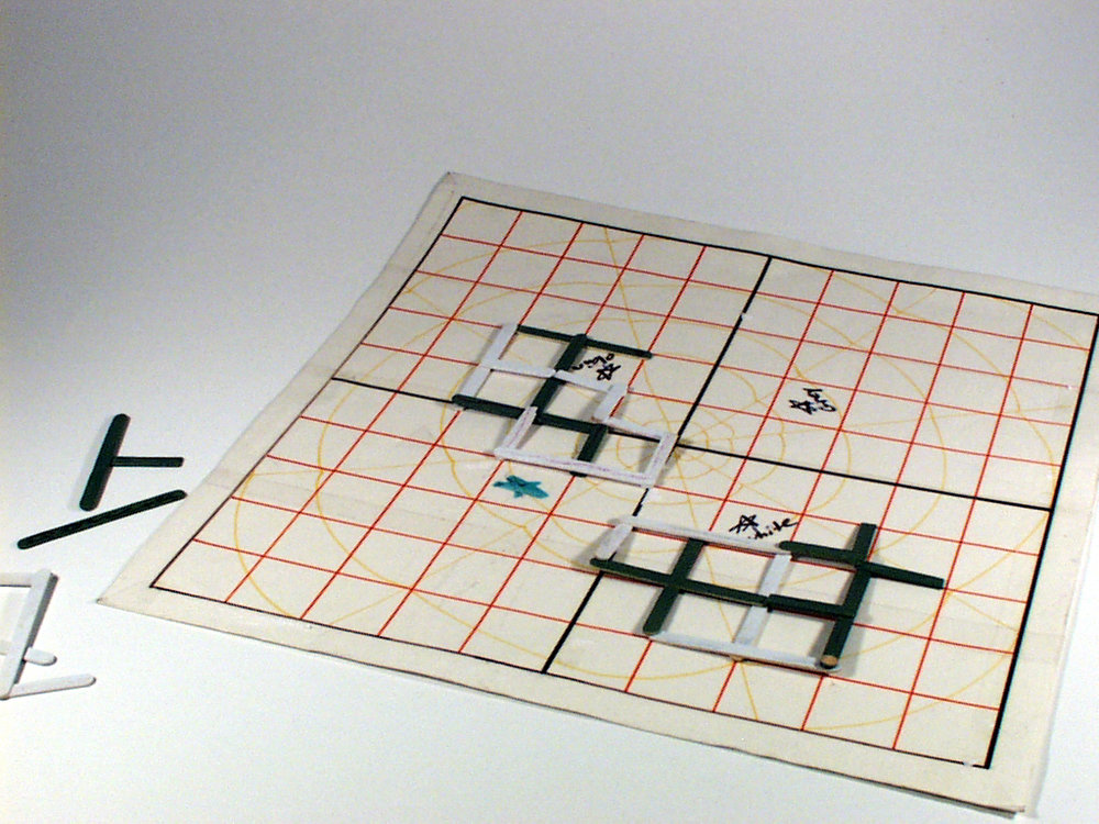 """Client's original product prototype for """"Spiderweb"""" board game."""