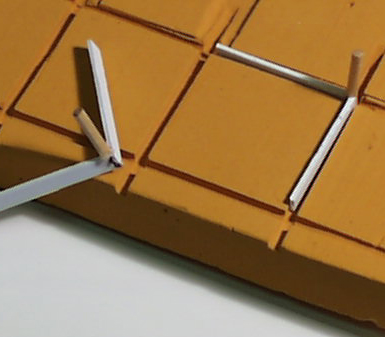 Design study for PVC molded board with slots for game pieces.