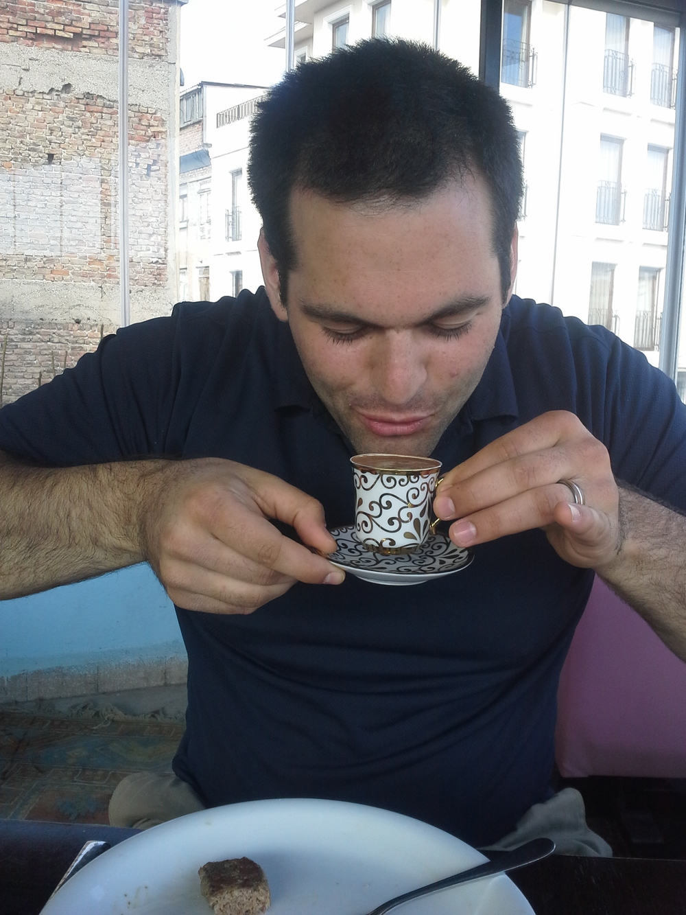 Pinkies out! Husband enjoying his Turkish coffee. You can also see the last bite of his lamb lunch. :)