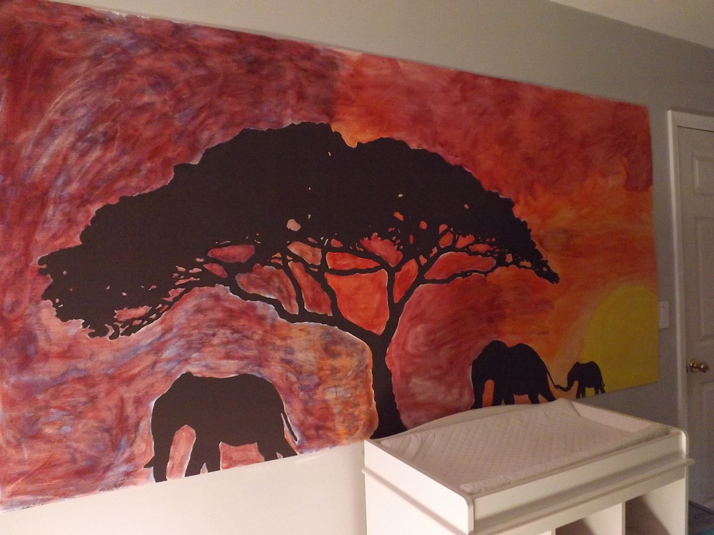 This mural is one of my favorite things in our house. I knew I wanted a mural in this room before we even got pregnant with A, and Husband, being the smart man that he is, suggested we paint it on a large piece of plywood rather than directly on the wall. That way we can take it with us whenever we move. I'm so glad we did because there is no way I'd want to leave it behind. My beautiful and talented sister-in-law (one of them, anyway) drew the picture, and a couple friends and I painted it.