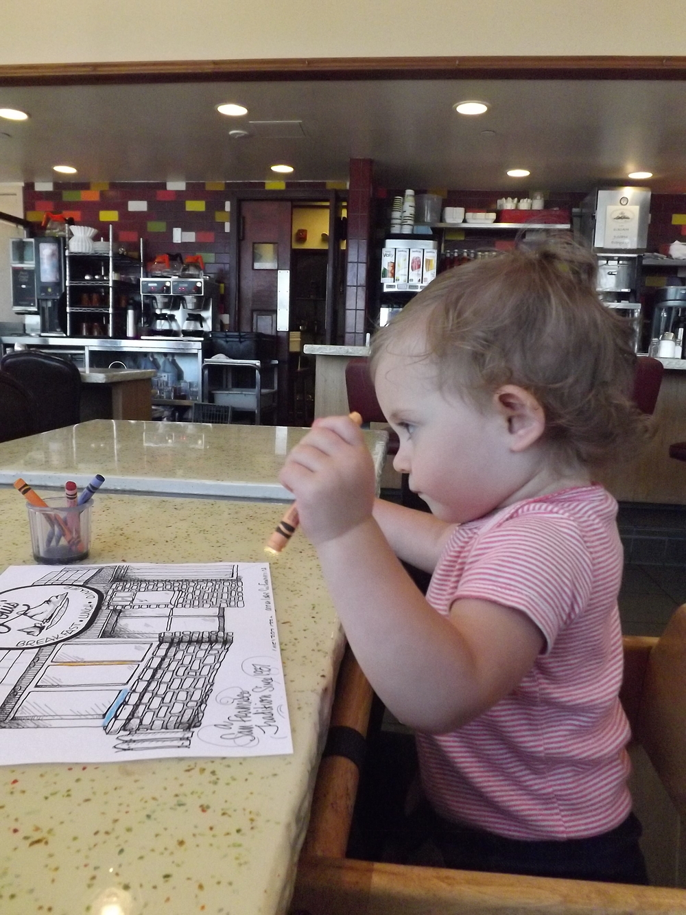 Our happy traveler coloring her picture while we wait for lunch to arrive