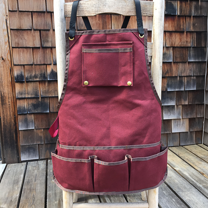 Wood working apron for Alvaro in Richmond, CA. Lots of pockets, hammer loop and swing-top chest pocket. Made from duck canvas and nylon webbing, brass hardware.