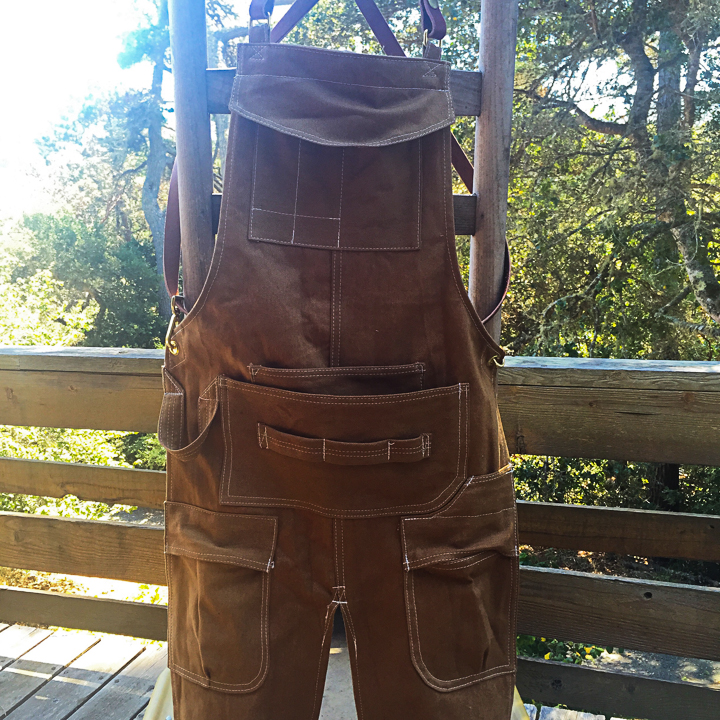 Woodworking apron for Ally in Baltimore, with legs! Heavy tan cotton twill with bridal leather straps and solid brass hardware.