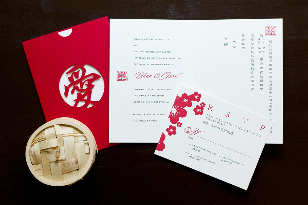 "Lillian and Jared   Special Design Notes:  ""Love"" laser cut pocket in red (available in other colors as special order); invitation printed in English and Chinese was inserted into pocket  Printing Method:  Letterpress / design can be offset printed  Paper:  Strathmore Natural White  As seen in:  Grace Ormonde Wedding Style Fall 2007"