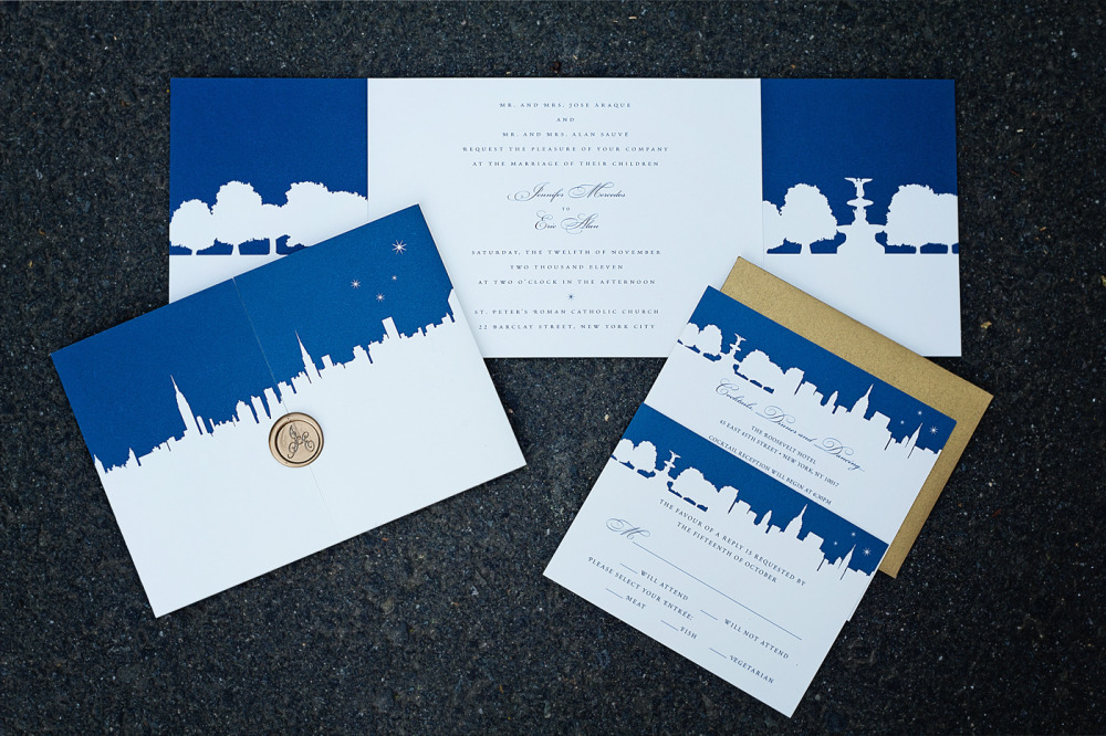 Jennifer and Eric   Special Design Notes:  Midtown skyline on the cover opens to reveal serene Central Park; custom wax seals  Printing Method:  Offset  Paper:  Strathmore coverstock  As seen in:  Original design for Diane and Blake featured in TimeOutNewYork.com, June 2011