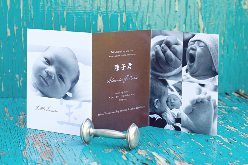 "Alexander   Special Design Notes /Theme:  Design incorporates up to 5 photos of your baby; incorporates Alexander's Chinese name; On the cover is the Chinese character for ""Little Treasure"". The folded announcement was tied together with matching light blue grosgrain ribbon.  Printing Method:  Digital press  Paper:  80# coverstock"