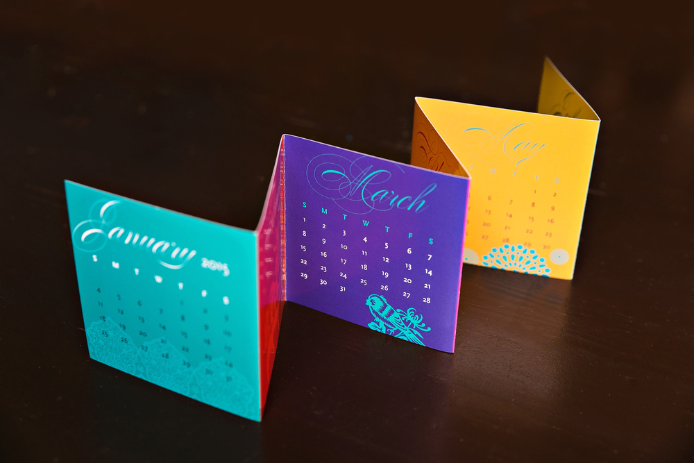 We designed and printed self-promotional, mini accordion calendars for the  News and Documentary  2014 Emmy Awards gift bags. The calendars were offset printed.  Photography by: Simply Sweet Snapshots