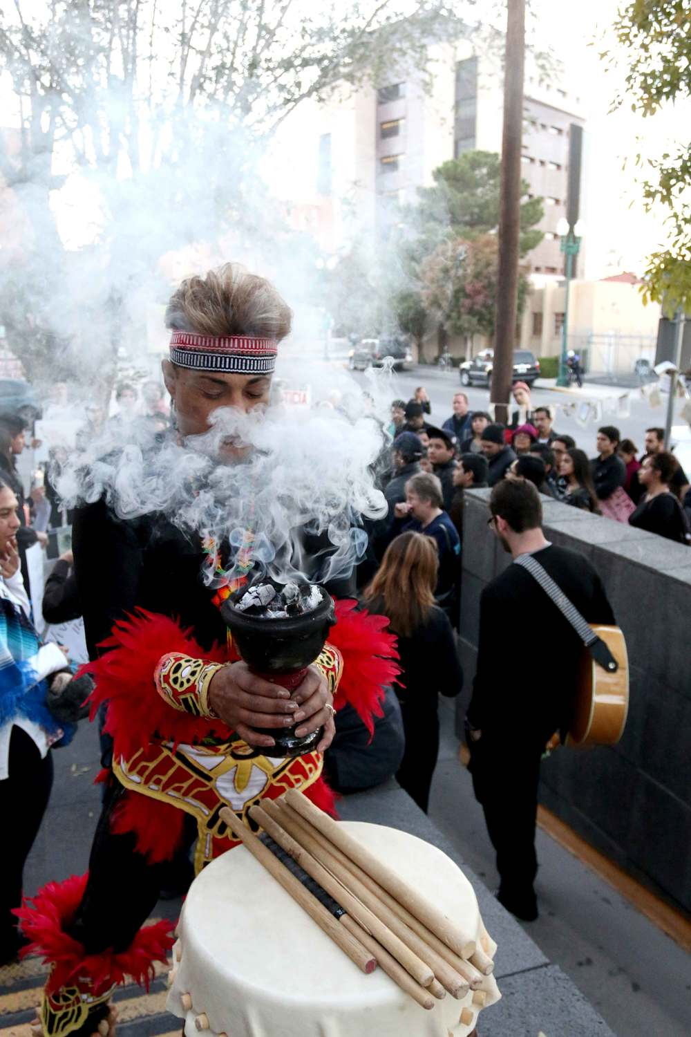 An El Pasoan performs a native ritual in front of the Consulate General of Mexico during a vigil for the 43 missing Ayotzinapa college students from Mexico on Nov. 21, 2014.