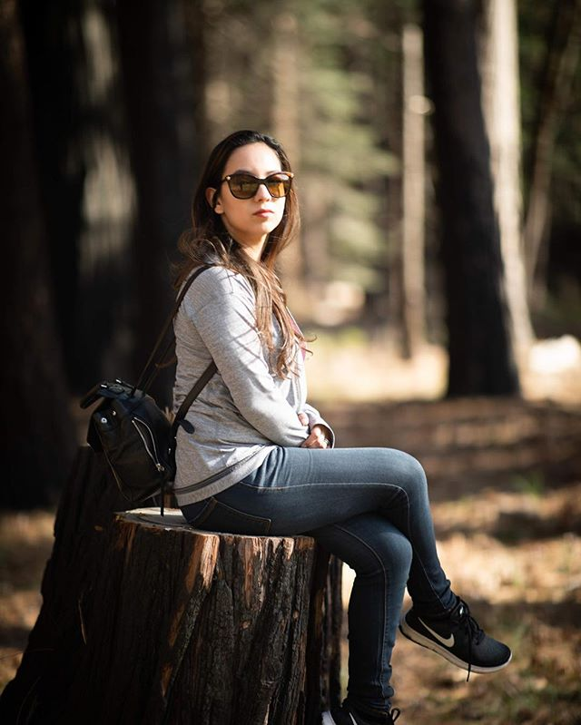 "The classic ""sitting on the tree stump thinking deep thoughts"" pose. This trip I really got to warm up to the Canon 85mm 1.4 lens. It's a fantastic lens, a little pricey, but the bokeh, colors, image stabilization, AF speed and build quality means this is a lens I'll be using for a very long time. At some point soon I'll do a lens shoot out with my two other portrait fav's: the 70-200 and the 50mm. #yosemite #canonphotography #canon85mm14 #supermodelwife"