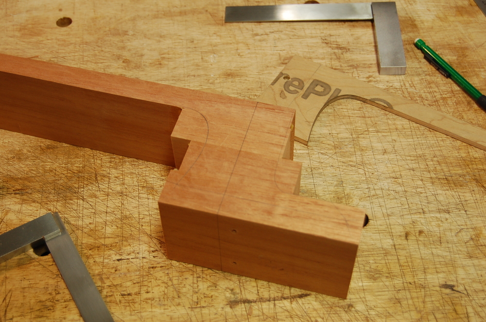 The Spanish Cedar heel is stacked and glued using two bamboo pins to keep the pieces from slipping.  I lay out the shape of the heel and foot on both sides with a template and bandsaw roughly to shape.