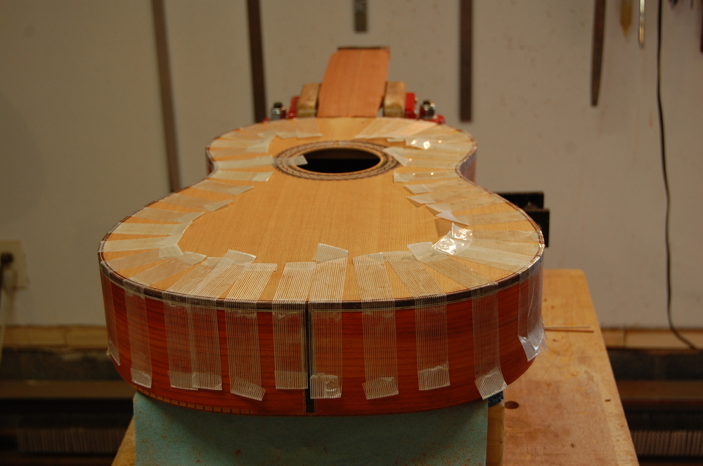 Strapping tape works wonders, providing plenty of gluing pressure.  Glue is painted into the channels with a brush.
