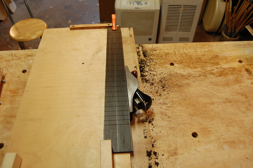 The slotted fingerboard is planed to the correct taper.