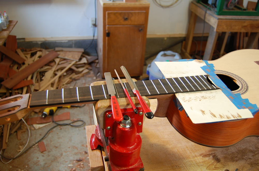 Dressing the frets with files.