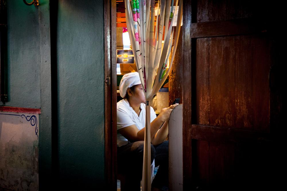 huahin girl in doorway-1.jpg