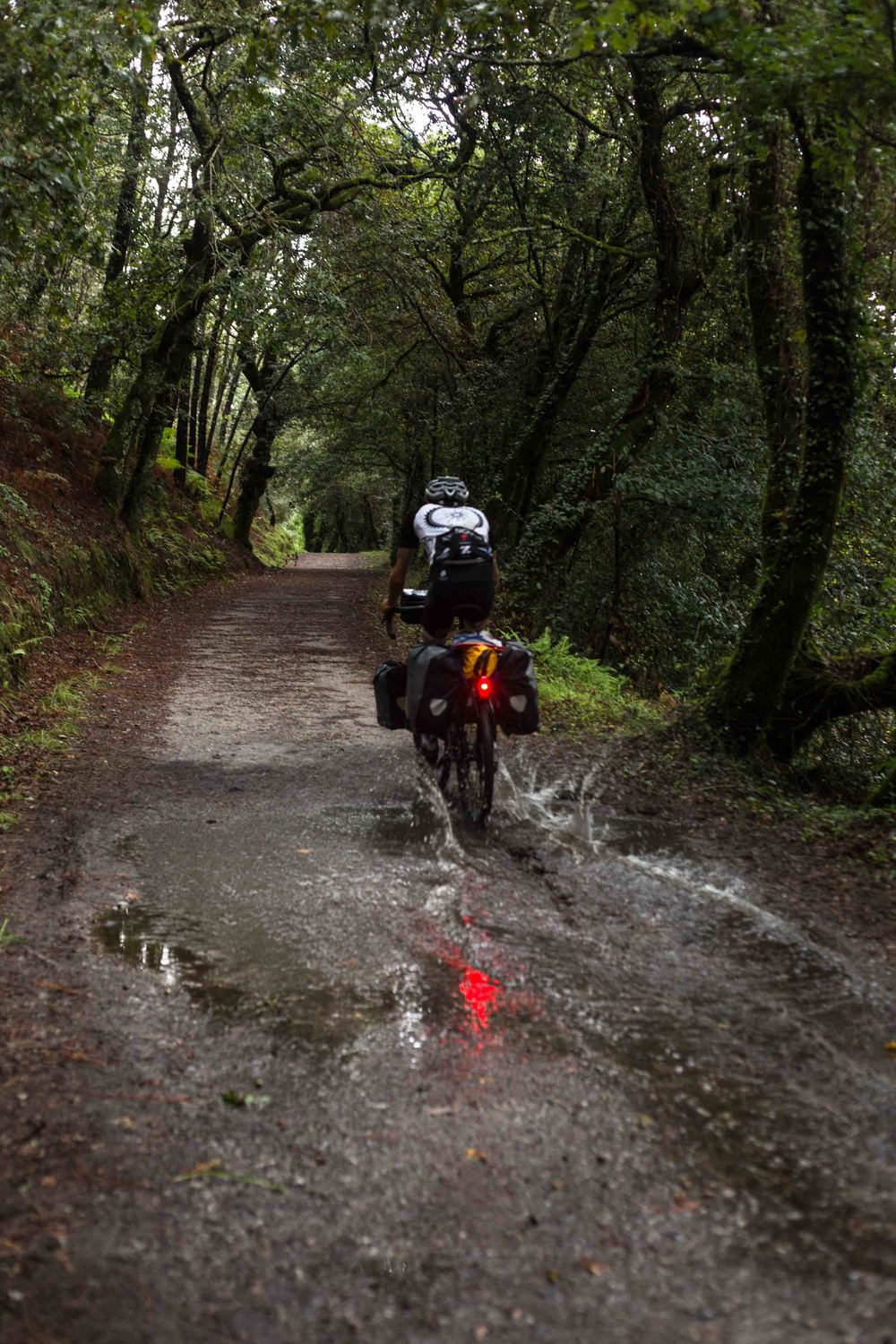 The Fly6 light/camera flashing in the mud as Keagan powers through the Camino.