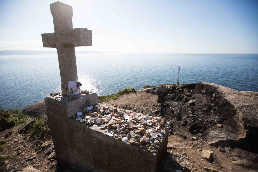 The end of the world is the last destination for pilgrims traveling along the Camino de Santiago, who leave burn their clothes to signify the end of their long journey.