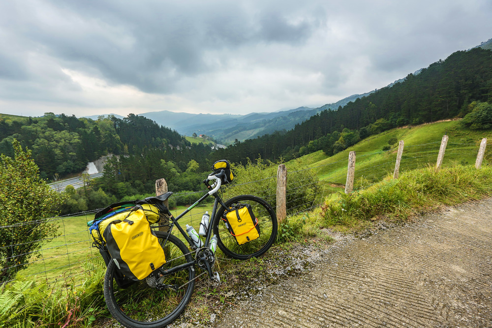 Rain or shine, views like this make riding bikes across countries something very special.