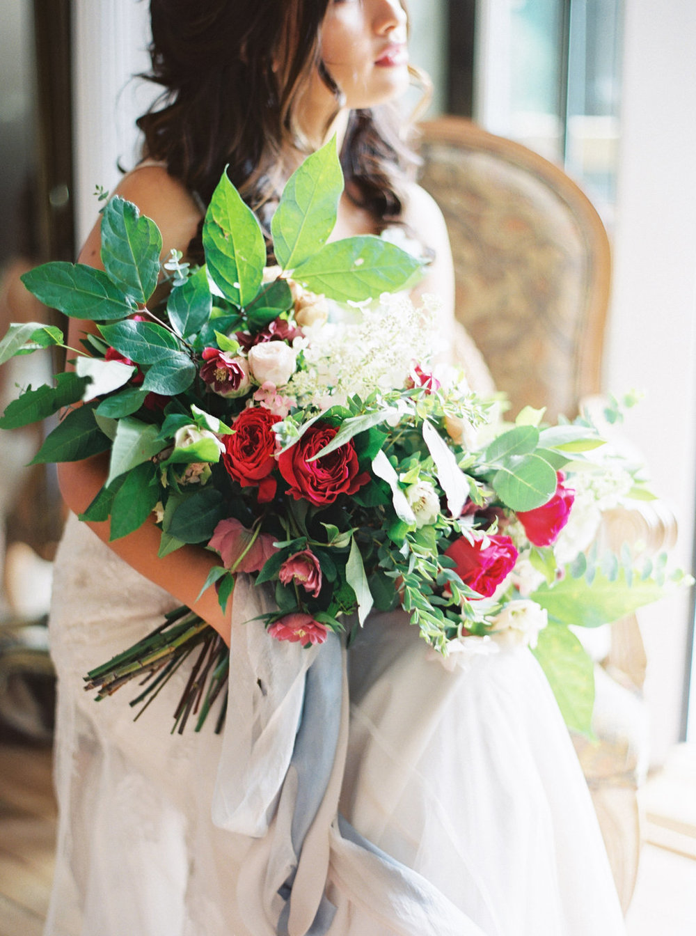 Bride with Blush and red wedding bouquet with silk and willow ribbon