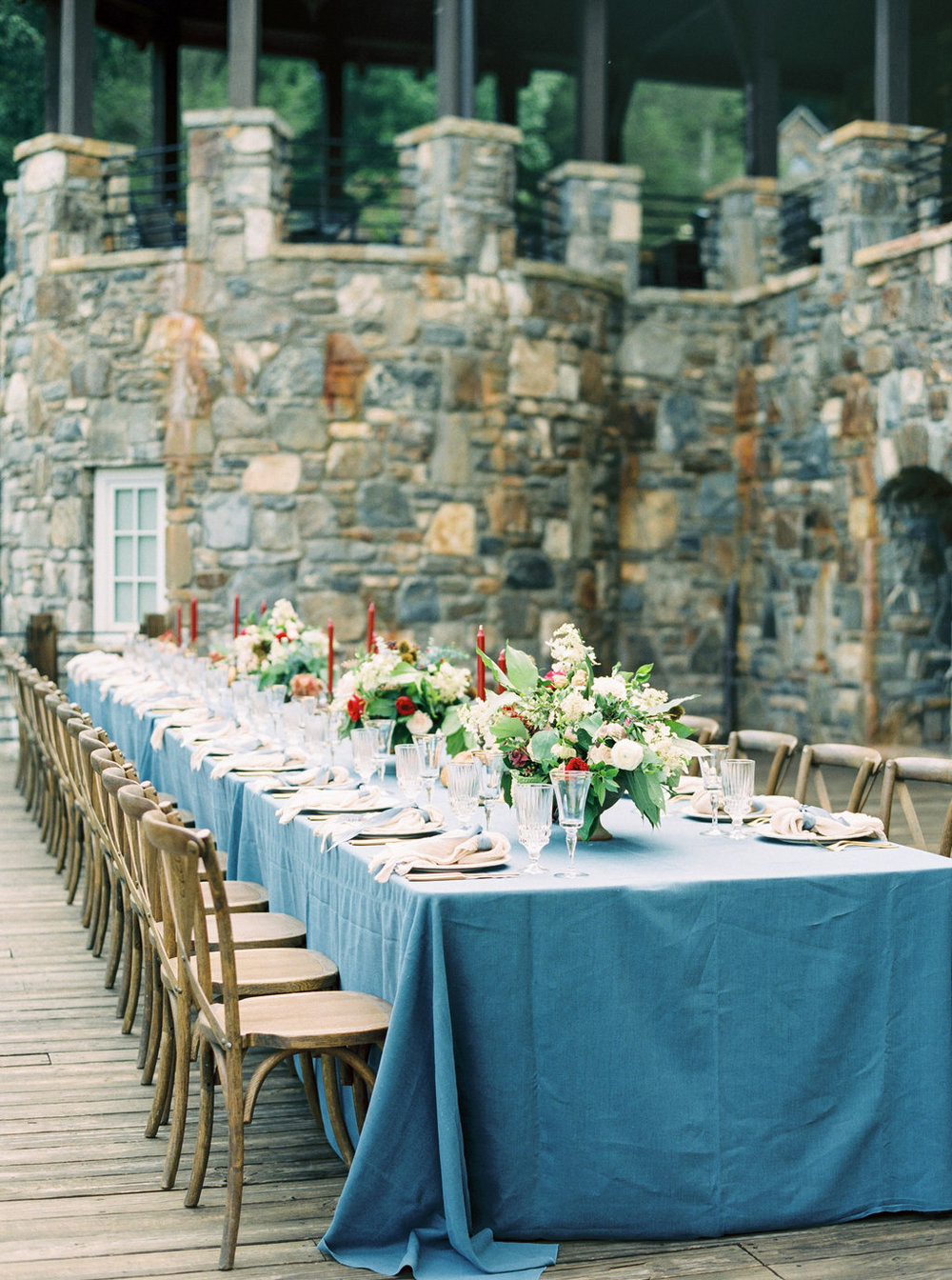 Blue, blush and red outdoor wedding reception at Castle Ladyhawk in North Carolina