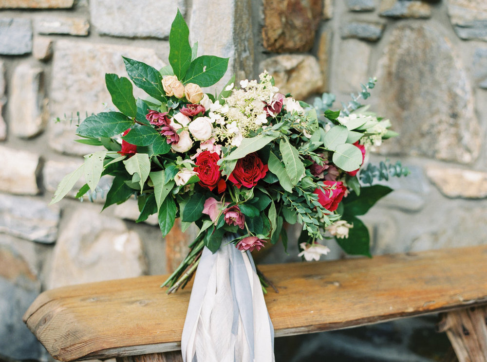 Blush and red wedding bouquet with silk and willow ribbon