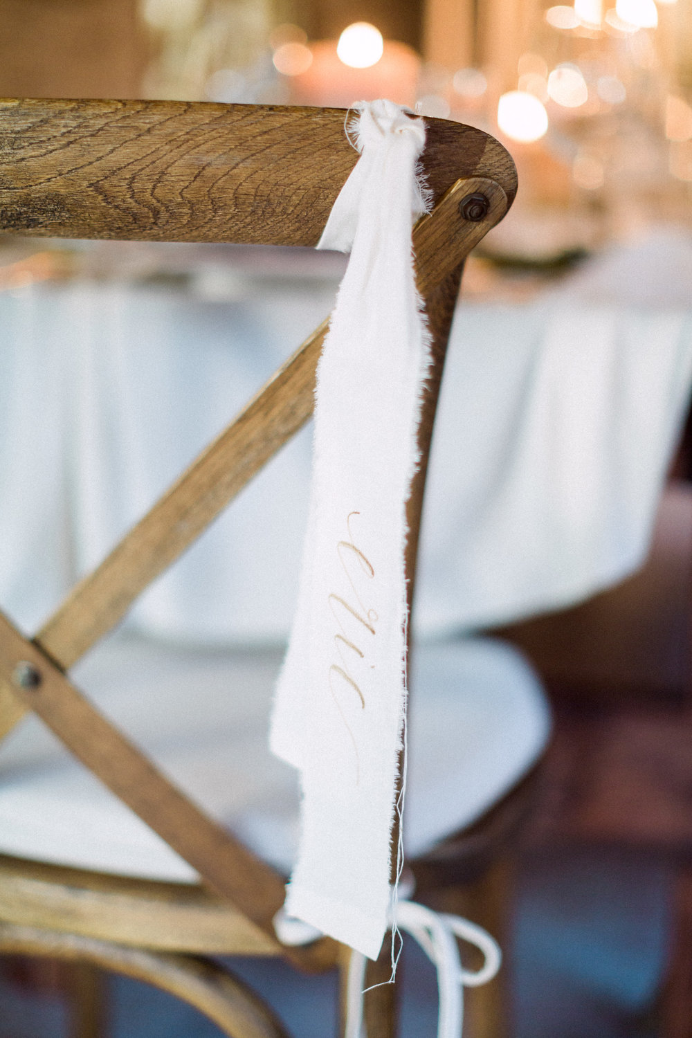 Fabric calligraphy place cards and x back chair