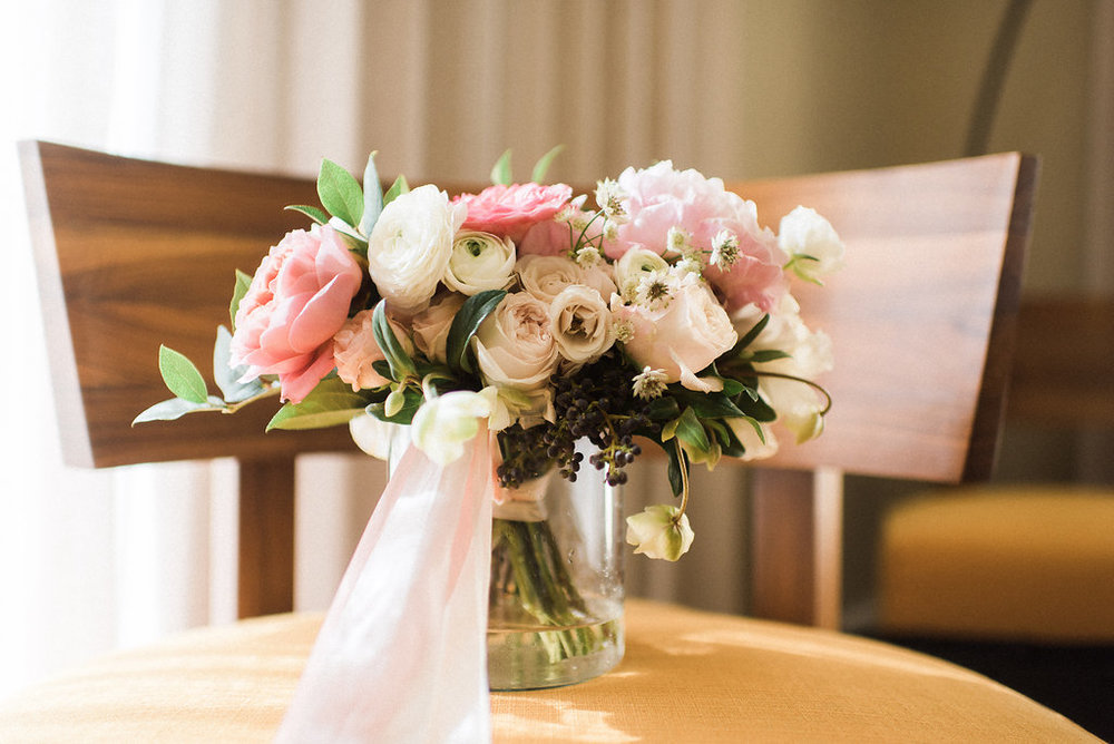 Blush garden style bridal bouquet with garden roses, peonies, and ranunculus