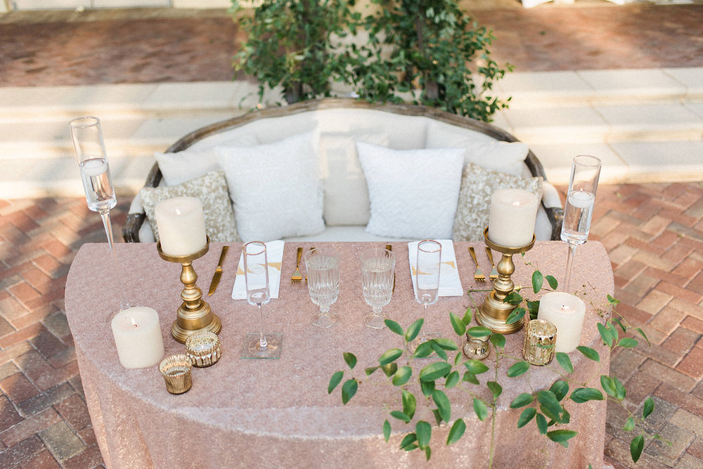 Blush and Gold sweetheart table with vines and candles