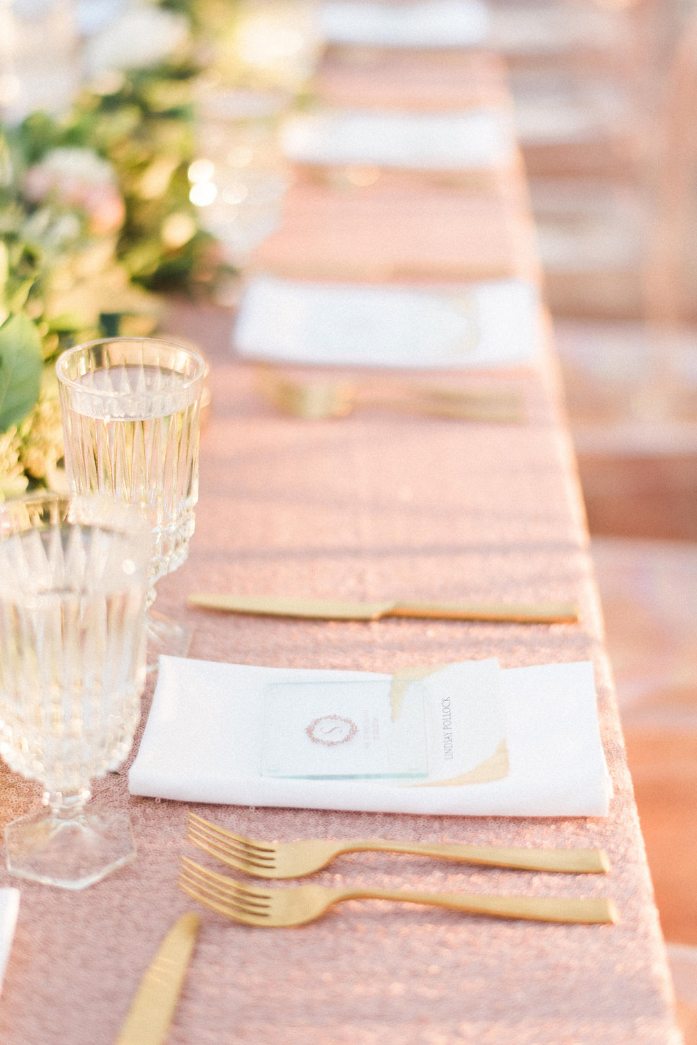 Blush and Gold wedding reception with garland centerpiece